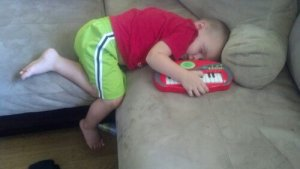 He fell asleep on the couch while trying to play.